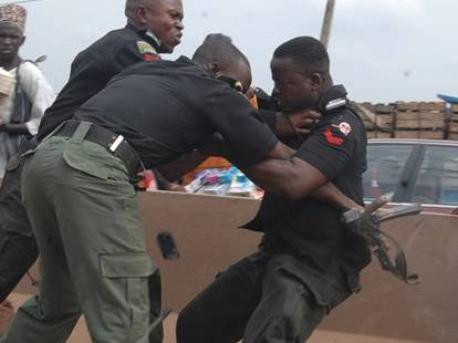 Image result for nigeria police collecting bribe and fighting