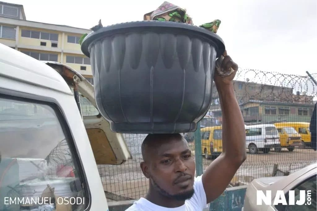 Meet Adeniyi Hammed, the 29-year-old man who sells Ofada rice for a living in Lagos (photos)