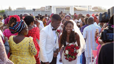 Photo of The Photographer and his model! Emmanuel Oyeleke and Nanfe Jemimah get married by the sea (photos)