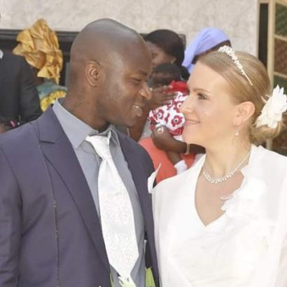 """Photo of """"You are the red oil to my yam, the ogiri in my soup"""" – White woman celebrates Nigerian husband on wedding anniversary"""