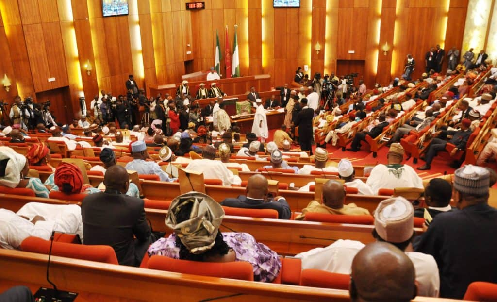 Photo of Drama as as PDP senators prevent colleague from defecting to APC
