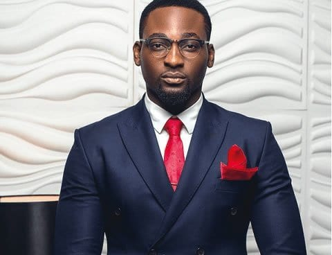 Photo of Actor Gbenro Ajibade serves Daddy's goal as he carries his daughter while cooking (Photo)