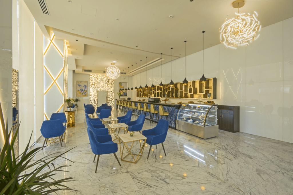 World s tallest hotel opens in dubai photos kemi for Gucci hotel dubai