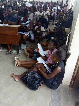 Photo of University students pictured sitting on the floor to receive lectures