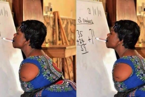 Photo of Picture of armless teacher writing with her teeth on the board goes viral
