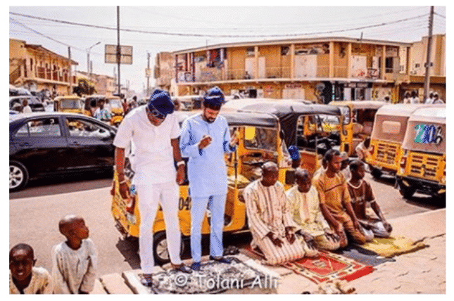 Photo of Oyo state's governor's son, Idris Ajimobi seen praying by the roadside (Picture)