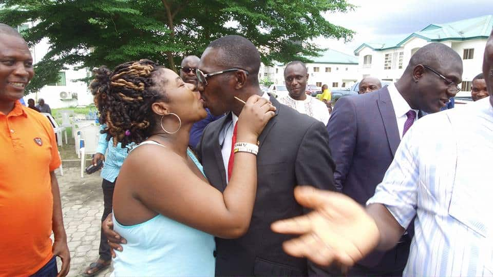 Photo of Nigerian man gets deep kiss from wife after he presented her with a brand new car