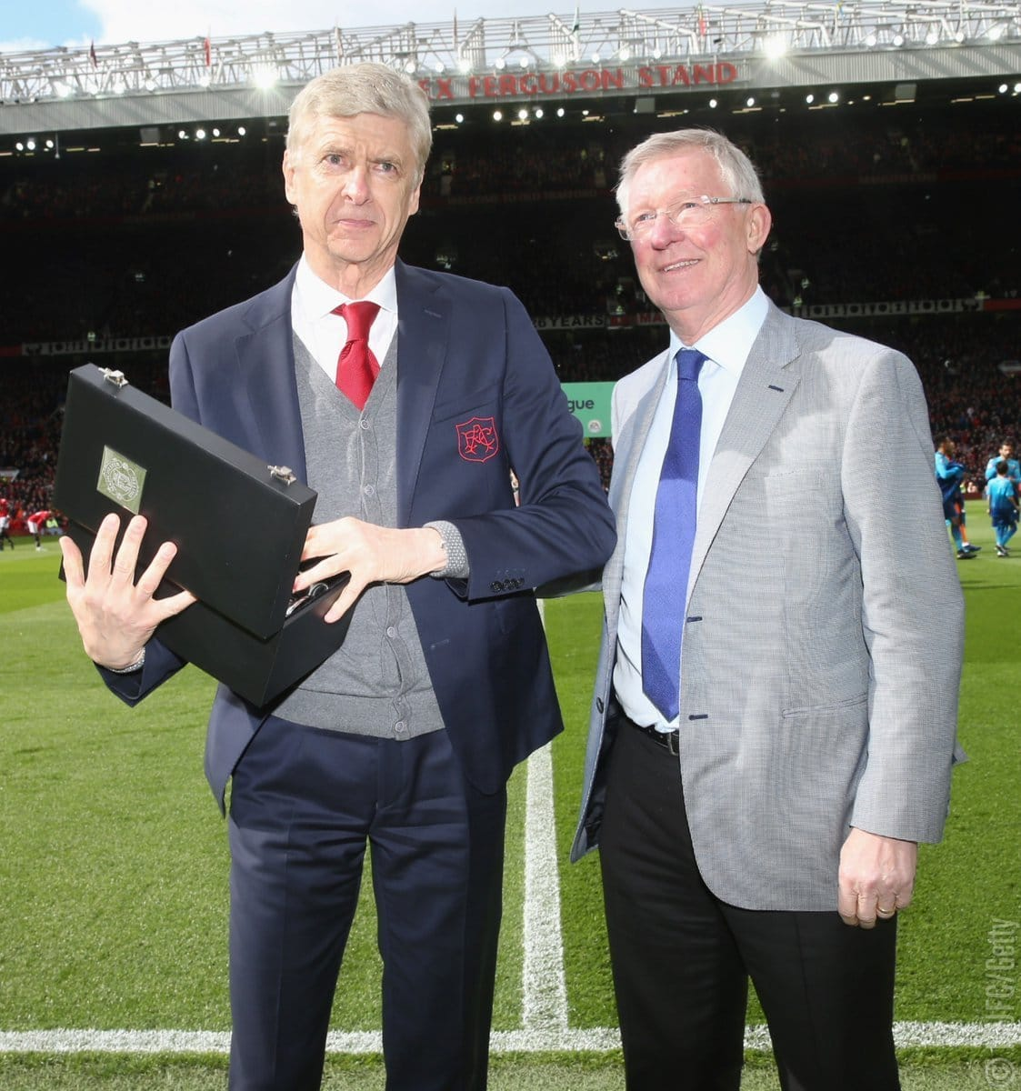 Arsene Wenger presented with a gift by Sir Alex Ferguson at Old Trafford