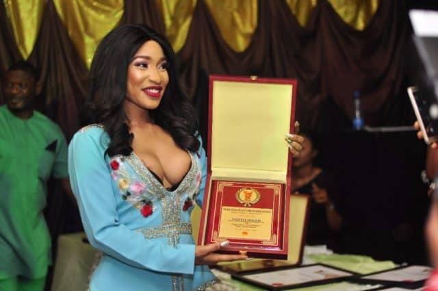 Photo of Tonto Dikeh stuns in cleavage-baring outfit as she bags peace award