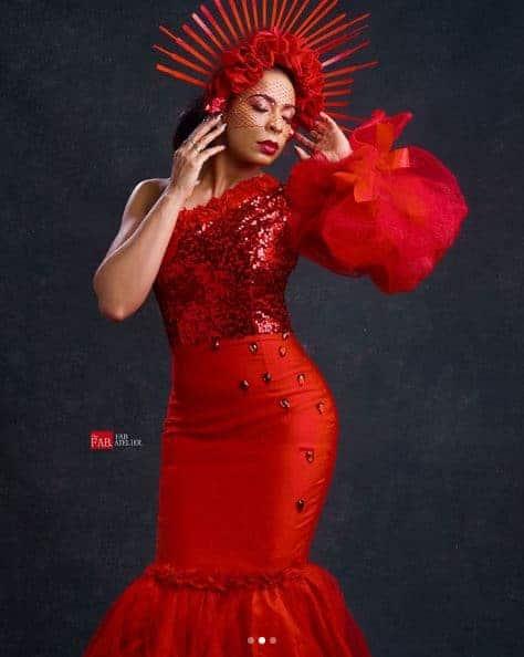 Tboss looks like a Greek goddess as she stuns in red dress