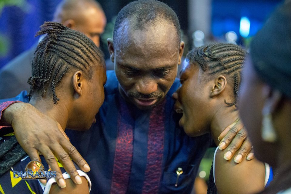 Photo of Dunamis pastor and his wife in tears after they healed twin sisters of insanity