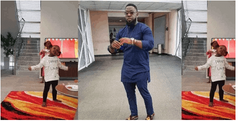 Photo of Timaya's daughters teach him how to dance their version of 'Shaku Shaku'