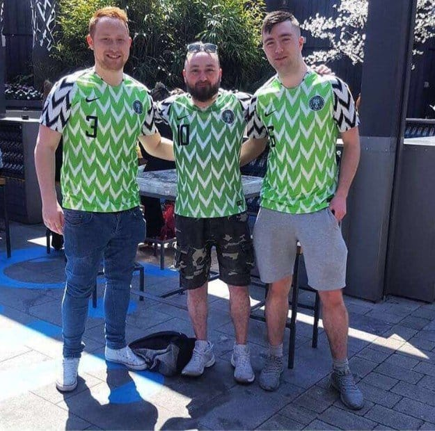 Photo of Photos of Oyinbo people rocking the Super Eagles jersey