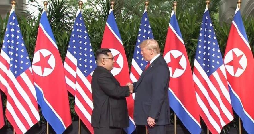 Trump and Kim Jong-un make history as they both shake hands