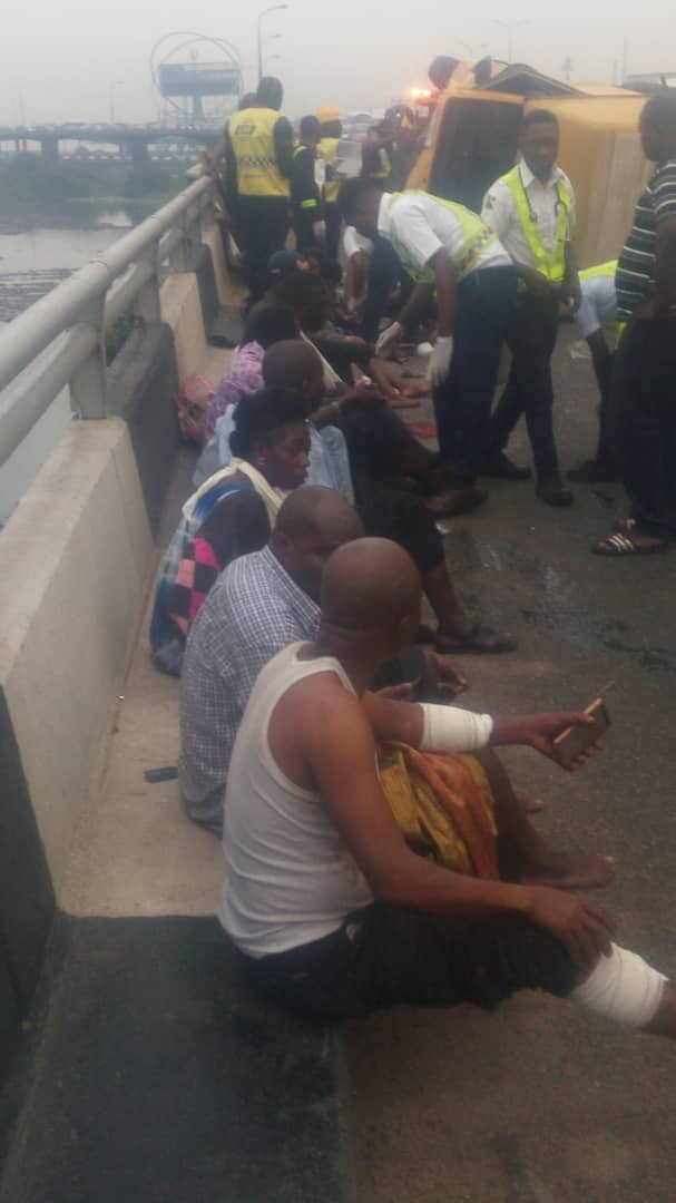 Photo of 22 passengers almost fall into the lagoon as bus somersaults on 3rd mainland bridge