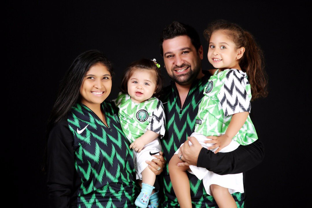 Photos of Oyinbo couple and their kids rocking the Super Eagles kits