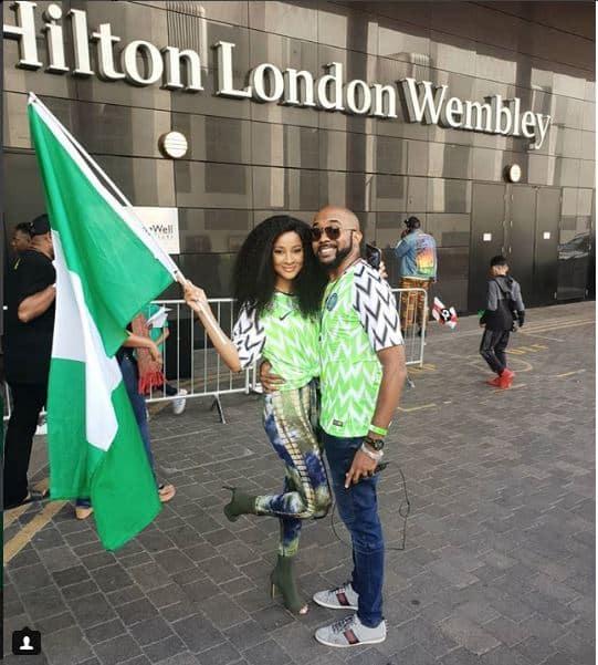 Photo of Banky W And Adesua Etomi rocking the Super Eagles' jersey at Wembley Stadium