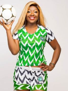 2eea89ca512 CUTIE! Lady Slays In Super Eagles  41K Jersey After Turning It Into ...