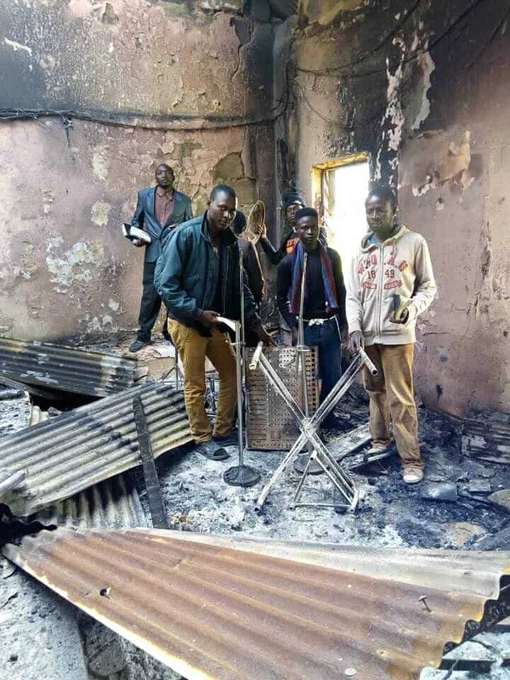 Photo of Residents worship in their burnt Church after Plateau massacre