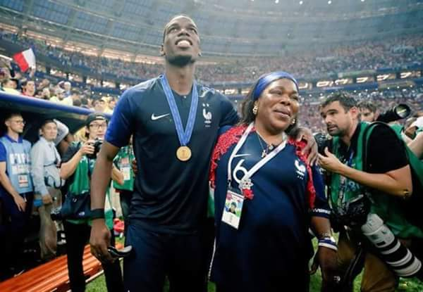Photos showing the moment Pogba and his mother posed with the world cup trophy