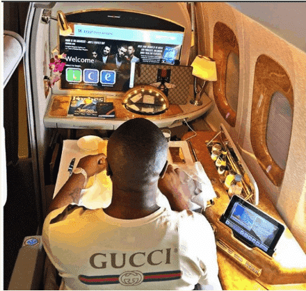 Photo of Hushpuppi watches tv on a plane, blasts haters