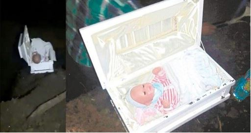 Photo of Father who thought he lost his baby discovers doll inside dead baby's coffin after girlfriend faked pregnancy