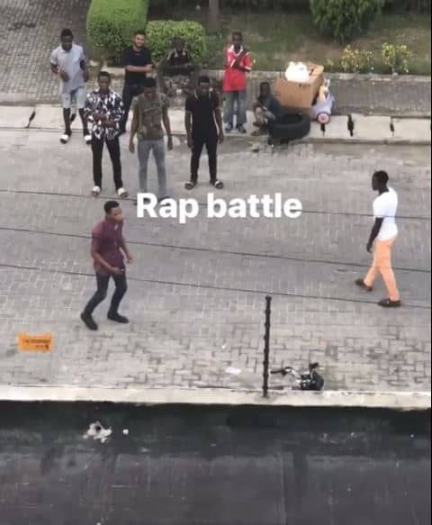 Photo of How young men engage in rap battles in-front of Davido's house when he is around