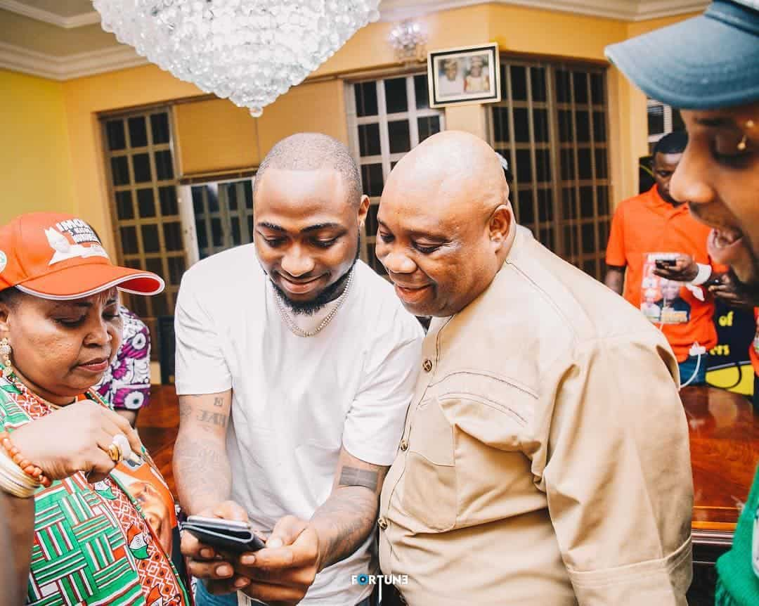 Photo of Davido lies flat on the ground as he greets his uncle, senator Ademola Adeleke