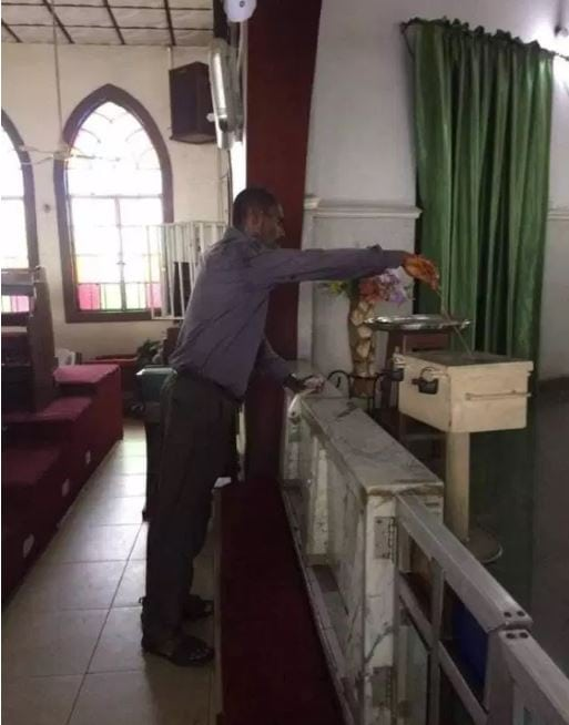 Photo of Man caught using wire to steal from a church tithe box