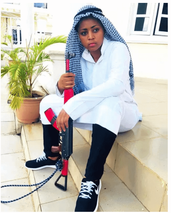 Photo of Regina Daniels slays in Arab Dress, pictured with an AK-47. (Photos)
