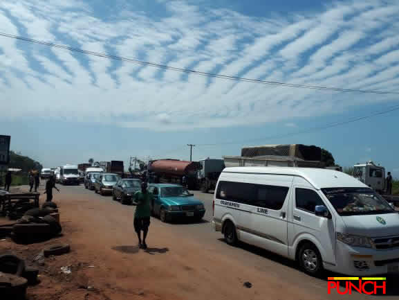 Photo of Protesters shut down Benin-Lagos Expressway, leave travelers stranded
