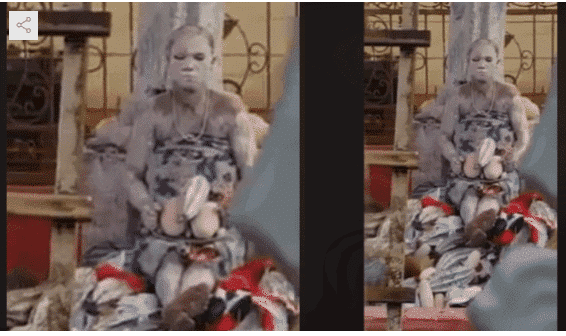 Photo of Strange lady spotted sitting in front of Emotan statue in Benin