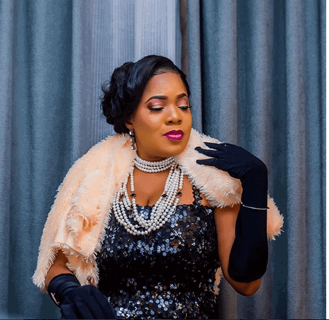 Photo of Toyin Abraham spotted with her new man and a baby bump