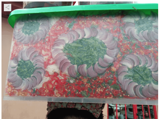 Photo of African salad hawker goes viral for her creativity