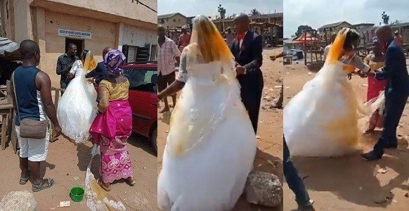 Photo of First wife pours palm oil on 2nd wife's wedding gown