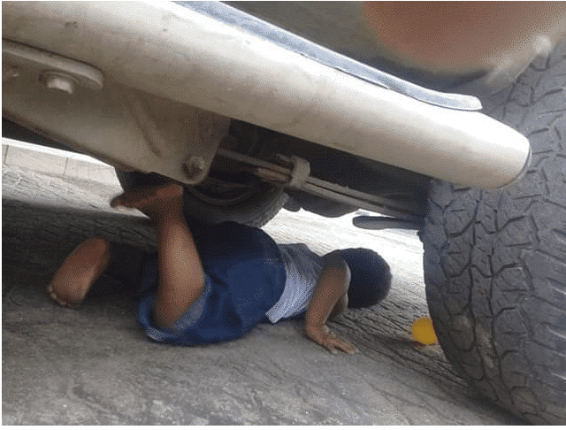 Photo of How man almost crushed his young son to death with his car