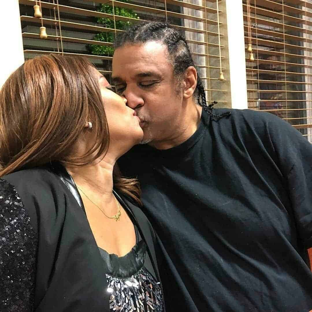 Photo of Regina Askia and husband share a kiss on her 51st birthday (Photos)