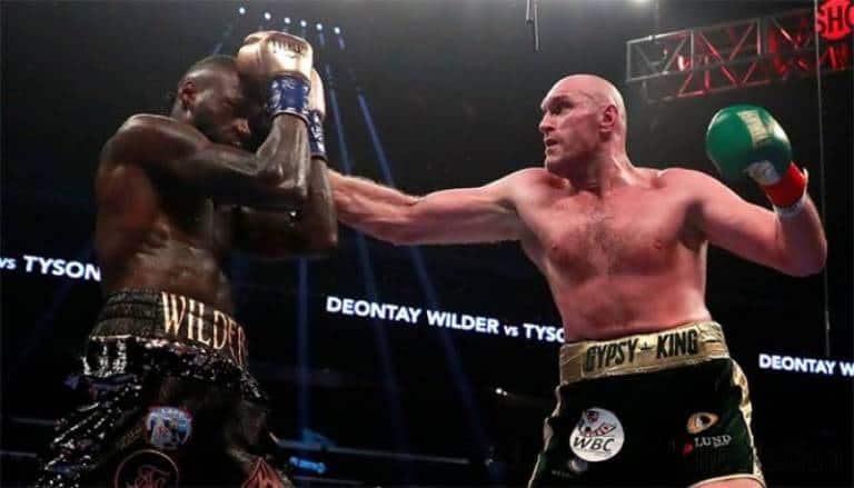 Photo of Deontay Wilder retains WBC heavyweight title by split draw with Tyson Fury