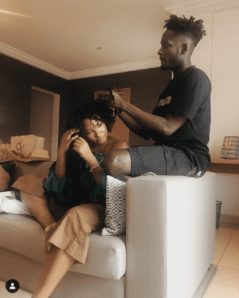 Photo of Mr Eazi and Temi Otedola share couple goals as he makes her hair