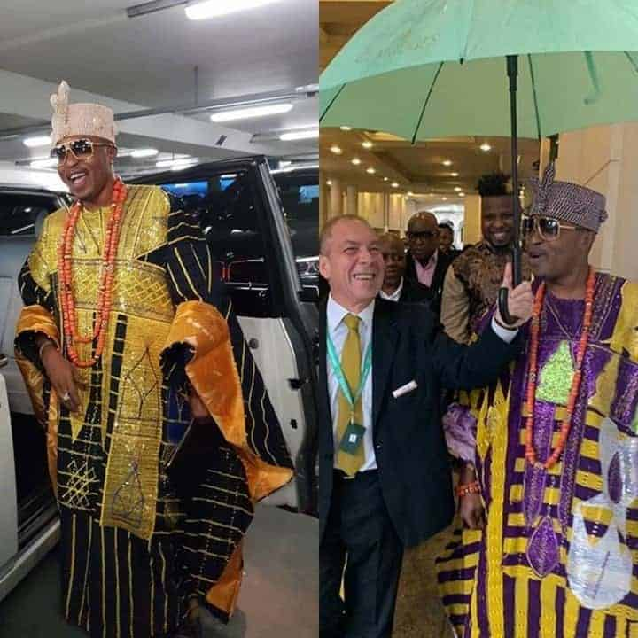 Photo of Oluwo of Iwo excited as white man holds umbrella for him in London