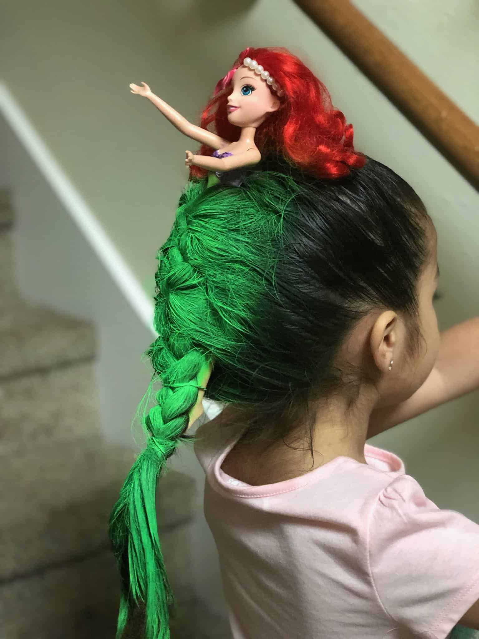 Photo of Little girl with mermaid hairdo wins crazy hairdo day at school
