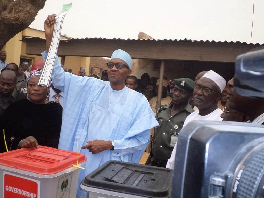 Photo of President Buhari and wife, Aisha vote in Daura