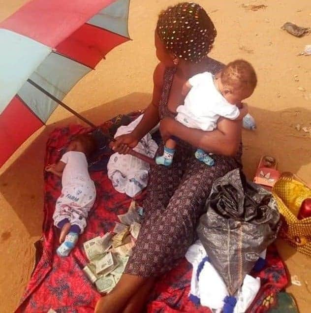 Photo of Young mother with newborn triplets spotted begging in Asaba after her husband allegedly absconded