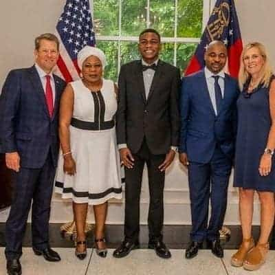 Image result for MC Oluomo and family strike a pose with Governor of Georgia, USA (photos)