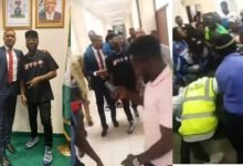 Photo of Security officials scrambe for money Davido gave them at the National Assembly (video)