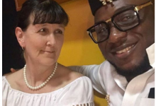 Photo of White woman lectures trolls saying her Nigerian husband married her for papers