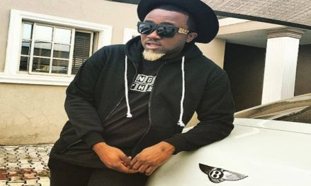 Ice prince posing with his Benz