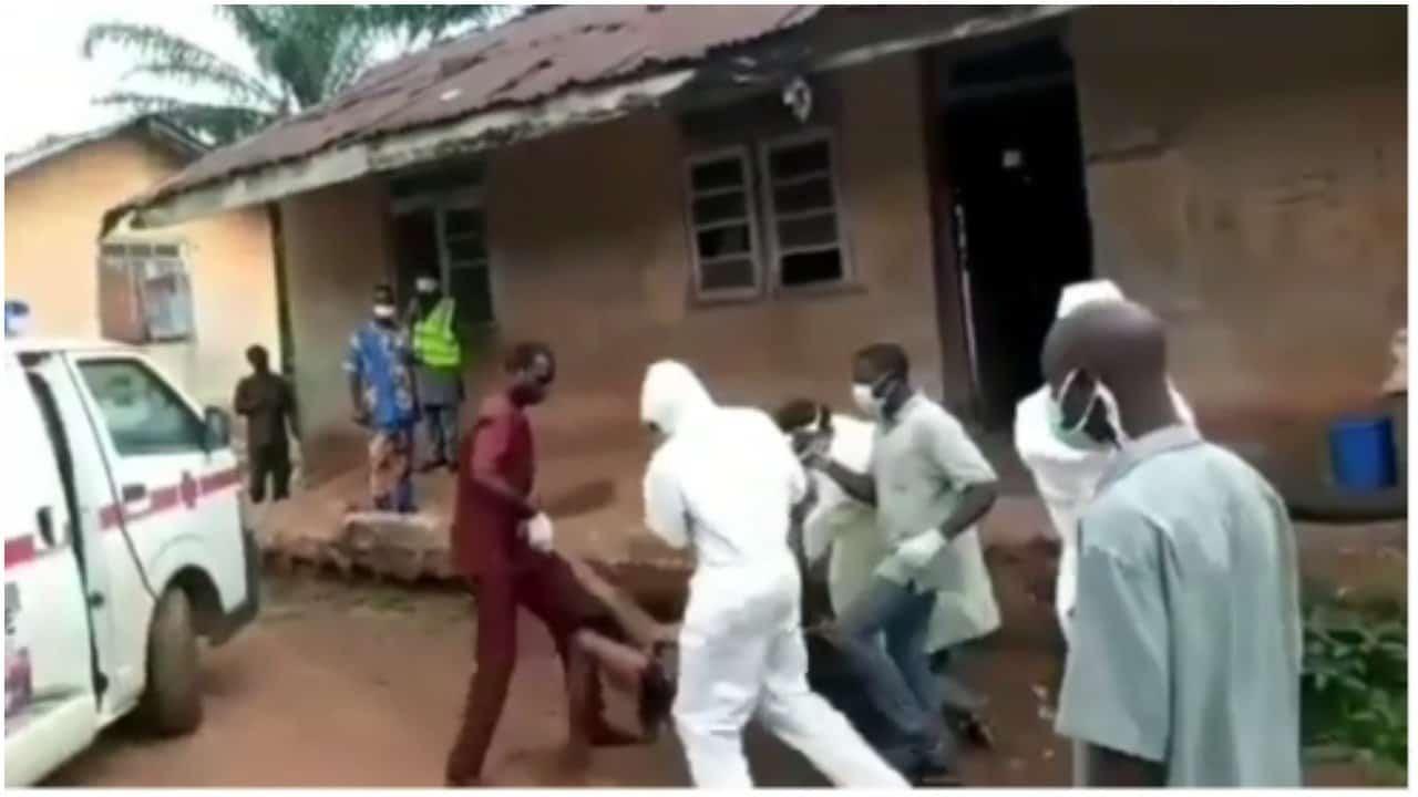 Coronavirus patient struggles with health workers