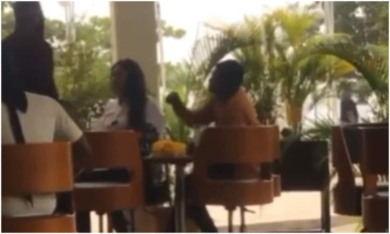 man snatches wig from his cheating girlfriend